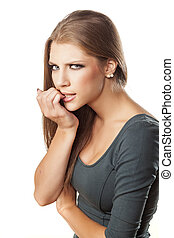upset girl - Attractive upset girl nibbling her nails