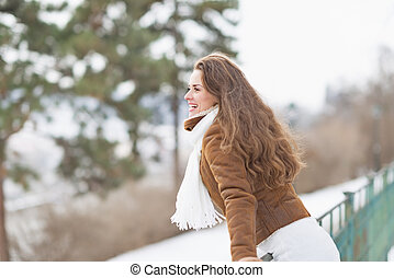 Happy young woman enjoying winter outdoors