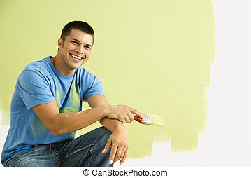 Smiling painting man.