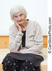 Retired life - Portrait of an elderly woman sitting on the...