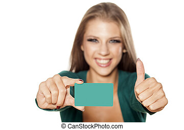 my new credit card - happy young attractive girl holding a...