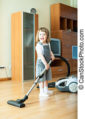 2 years girl with vacuum cleaner