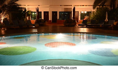 The swimming pool with jacuzzi at luxury hotel in night...