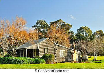 group settlement house - weatherboard house in lush winter...