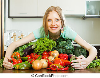 woman with heap of vegetables - woman with heap of...
