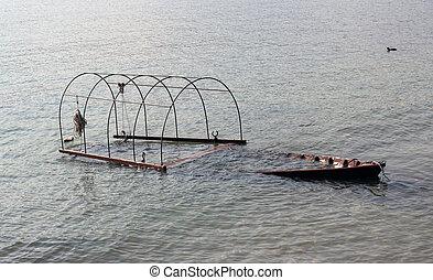 sunk boat - old boat sunk in Maggiore Lake, Italy