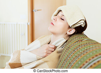sick young woman uses handkerchief on her head - sick young...