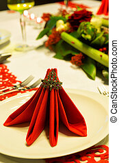 Folded napkins on christmas table - Christmas table...