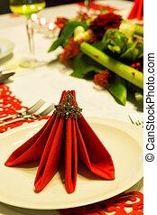 Folded napkins on christmas table