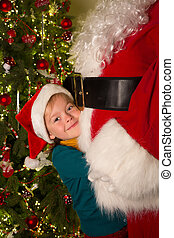 Big hug for santa claus - Happy little girl giving santa...