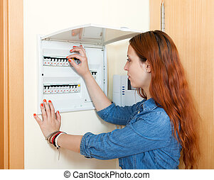 Woman turning off the light-switch - woman turning off the...