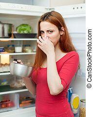 woman  holding  nose because of bad smell
