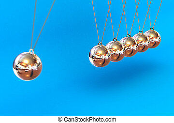 Newtons Cradle on a Blue Background