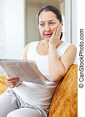 surprised woman with newspaper - surprised woman with...