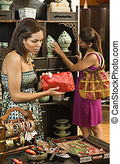 Women in boutique - African American and Indian women...