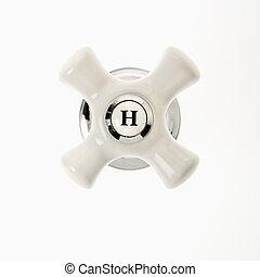 Hot faucet handle. - Hot faucet handle against white...