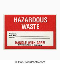 Hazardous waste sign. - Hazardous waste sign against white...