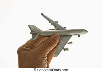 Toy airplane - Hand holding toy airplane