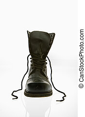 Combat boot - One black leather high top boots with untied...