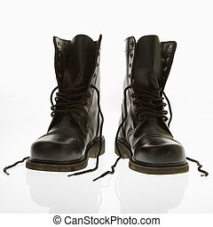 Combat boots. - Black leather high top boots with untied...