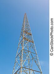 tower and radio antenna on a background of blue sky