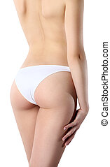 Bum and legs of slim woman over white background - Beautiful...