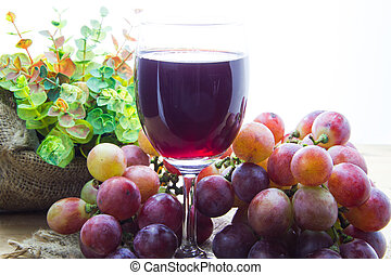 Glass of grape juice and grape fruit