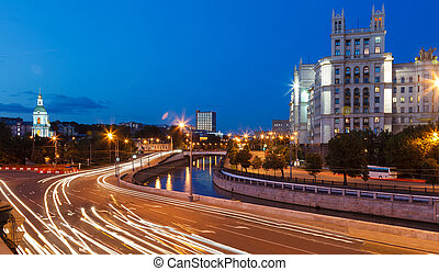road traffic in the evening on embankment of the Moscow...