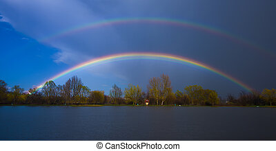 double rainbow over the lake