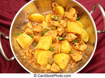Vindaloo in a kadai - A vindaloo chicken and potato curry,...