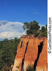 Ochre rocks in Roussillion, France - Orange ochre rocks in...