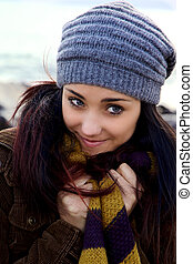 Smiling beauty in autumn with scarf and hat