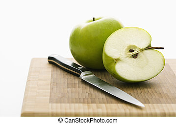Granny Smith apples. - Still life of green apples and knife...