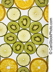 Fruit slices - Assorted fruit slices arranged in pattern on...