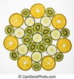 Assorted fruit. - Assorted fruit slices arranged in pattern...