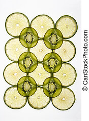 Kiwi and lime - Lime and kiwi fruit slices arranged on white...