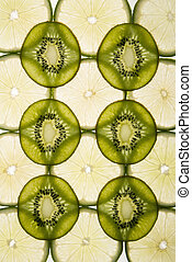 Lime and kiwi - Lime and kiwi fruit slices arranged on white...