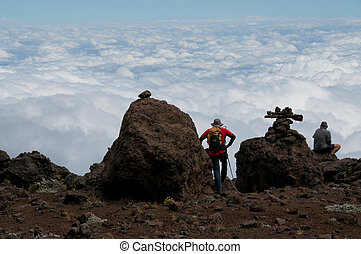 Trekkers gazing over the clouds - On the trail to...
