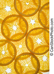 Fruit slices. - Orange slices arranged in design on white...