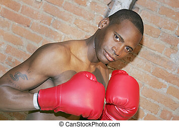 boxer guy - a young black male preparing to fight with taped...
