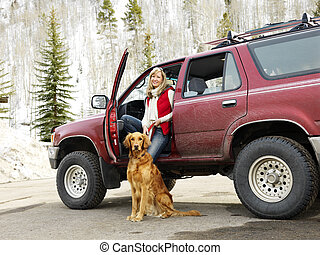 Woman and pet. - Woman with dog sitting with dirt splattered...