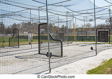 Batting Cages in Park - Chain link batting cages in a public...