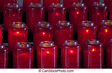 prayer candles - red candles in glass some burning in the...