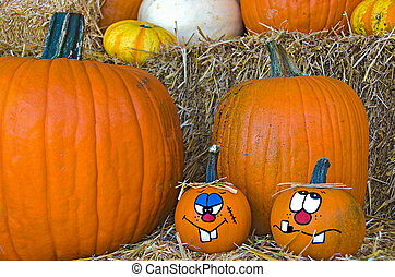 fun fall pumpkins - Painted faces on autumn pumpkins on hay...