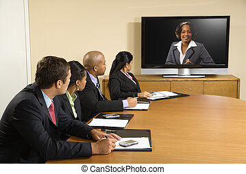 Business conference - Businesspeople sitting at conference...
