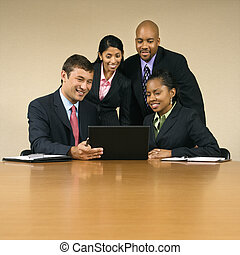 Businesspeople with computer. - Businesspeople gathered...