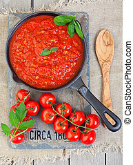Sauce From Heirloom Tomatoes - A cast iron pan filled with...