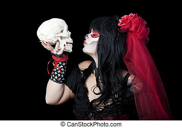 Kissing Sugar Skull - Day of The Dead. A woman dressed as a...