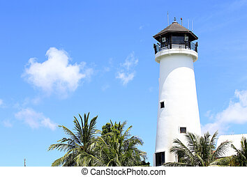 lighthouse at the marina against blue sky