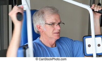 Senior Chest Exercising - Senior adult male works out his...